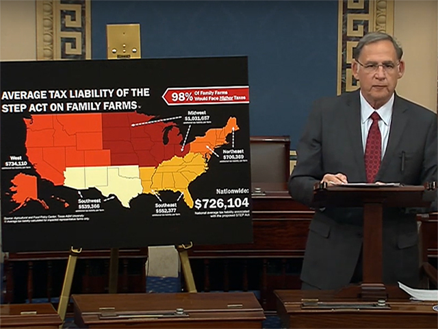 Sen. John Boozman, R-Ark., speaking on the U.S. Senate floor Wednesday, with a map showing projected increases in tax liability under plans to eliminate stepped-up basis for farms and ranches and raise capital-gains rates for inherited assets. The map was based on an analysis done by Texas A and M Agricultural and Food Policy Center. (Image courtesy of Senate Agriculture Committee minority staff)
